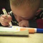 Our nephew Hayden coloring away at Doc's Pizza in Rupert