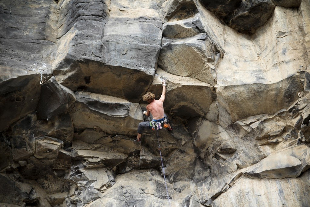 Moving into the lower crux on Soloflex (5.12c)
