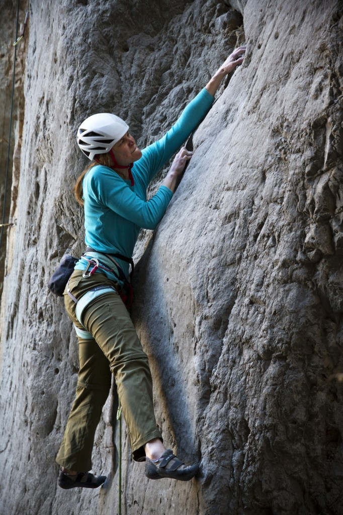 Dana mid crux on an Unknown bouldery 5.12a/b at The Grail.