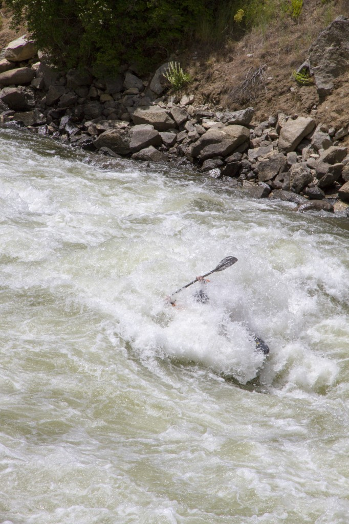 A rad kayaker hitting some waves on one of the many world class rivers we passed.
