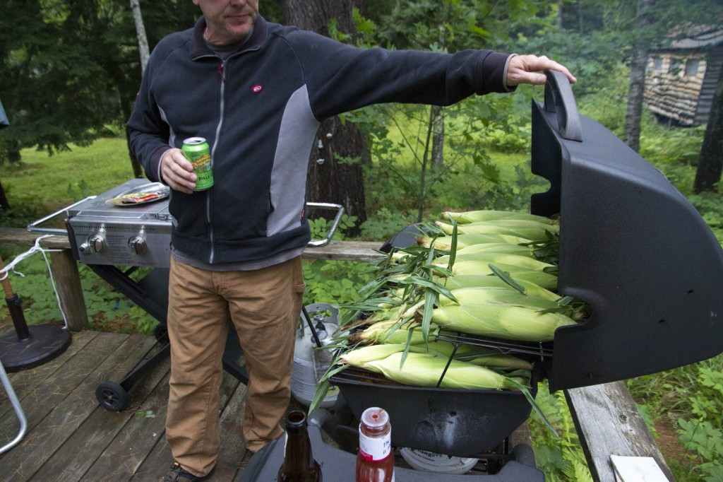 Dad cookin' corn on the cob in the BBQ.