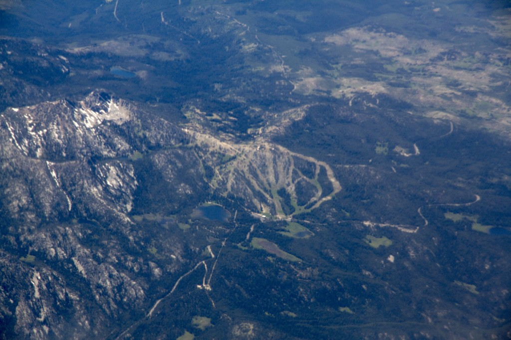 This was a real treat. I was looking out the window on our flight from Seattle to Boise thinking that I might be able to recognize some of the mountain ranges (Wallowas, Elkhorns etc) after living in the area most of my life. As I was convinced I was in the Baker Valley loandbehold I spotted Anthony Lakes!! I grew up skiing this one lift mountain from ages 12-18. Such a cool sight from the air. Gunsight peak to the left, Anthony Lake at the bottom and you can even spot the old lodge.