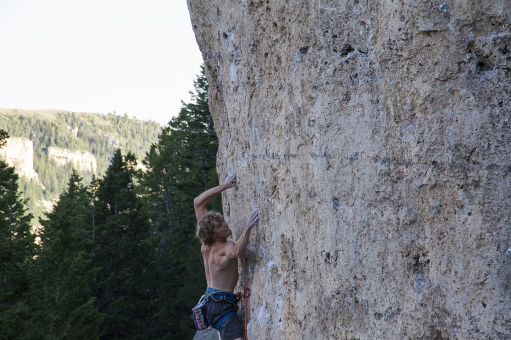 Trying hard on a trick spot. Happiness in Slavery (5.12b).