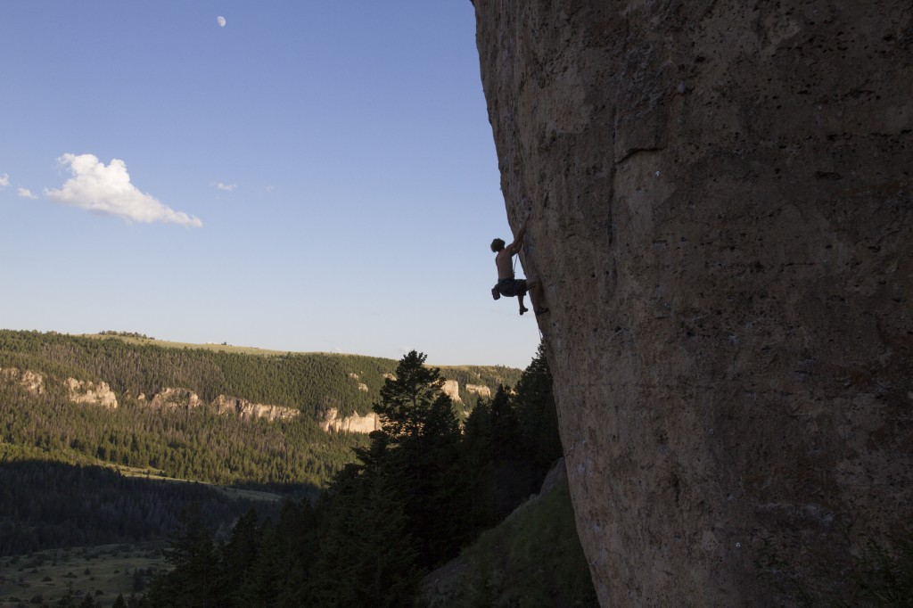 Happiness in Slavery (5.12b) with the endless dolomite of Ten Sleep tracing the canyon walls. Good climbing temps are from about 1:30 PM till dark during July. Often we were treated to a stunning orange and pink light show on the opposite side of the canyon as we hiked out.