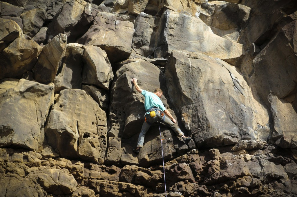 Pat in the crux of Sanitary Landfill (5.10b) at The Alcove.