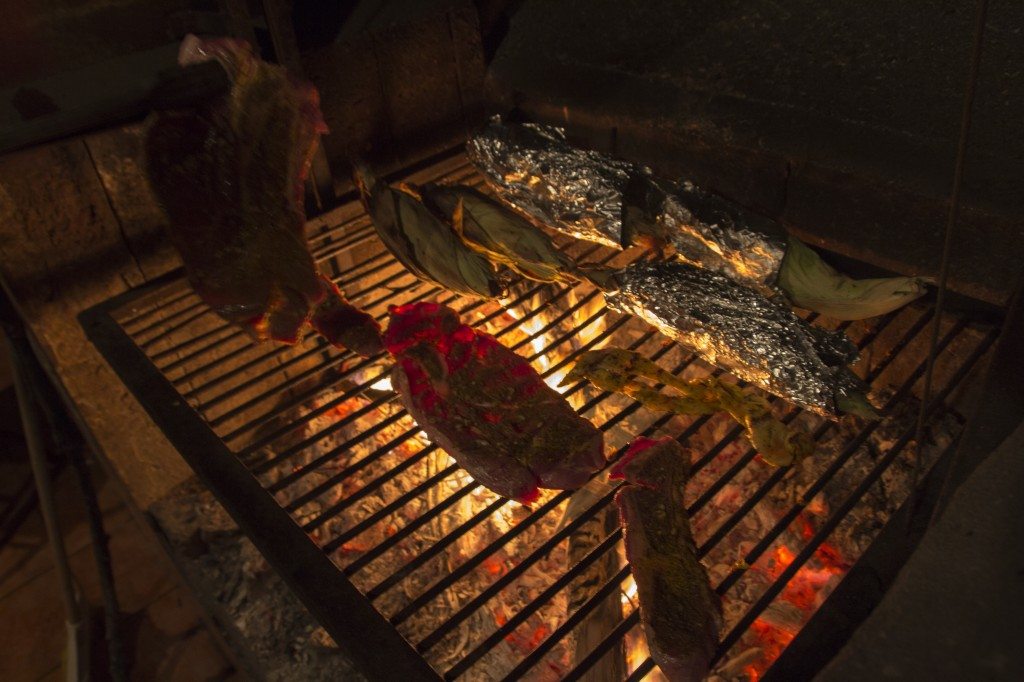 Meat and chewy corn. Christmas dinner over a wood fired BBQ in Nuevo Leon, Mexico.