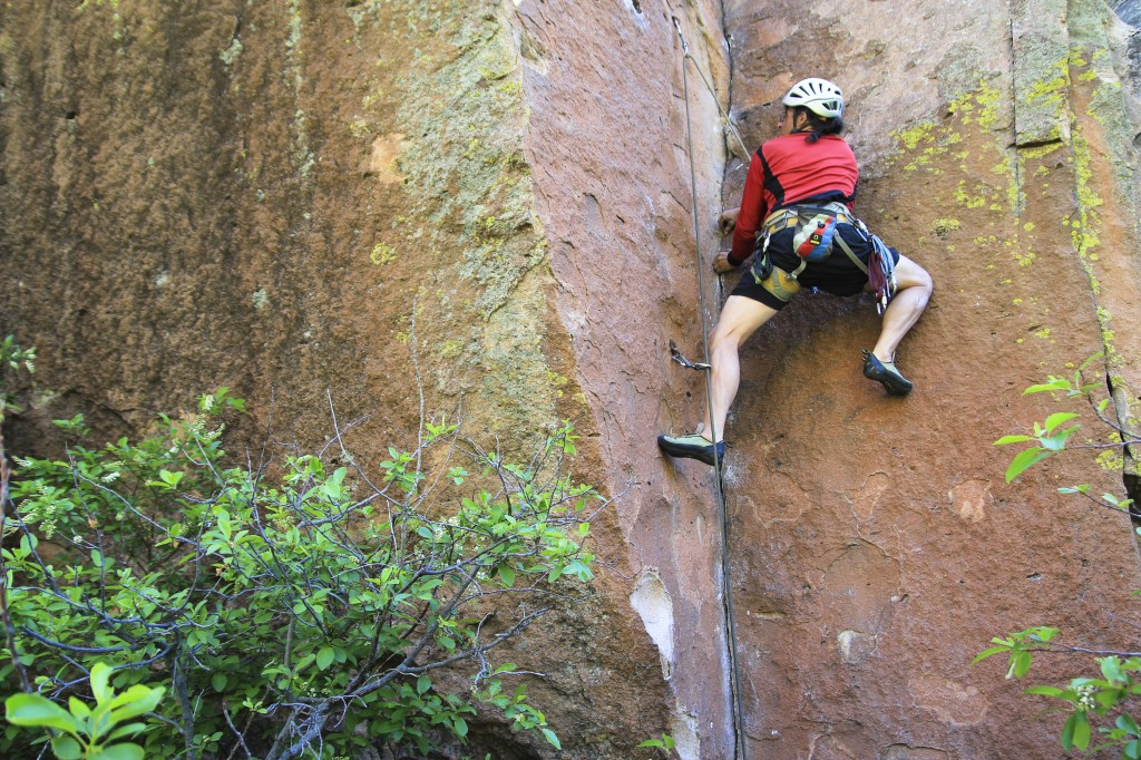 Bruno on the challenging Dos Hombres 5.11b stemming corner in Penitente Canyon.