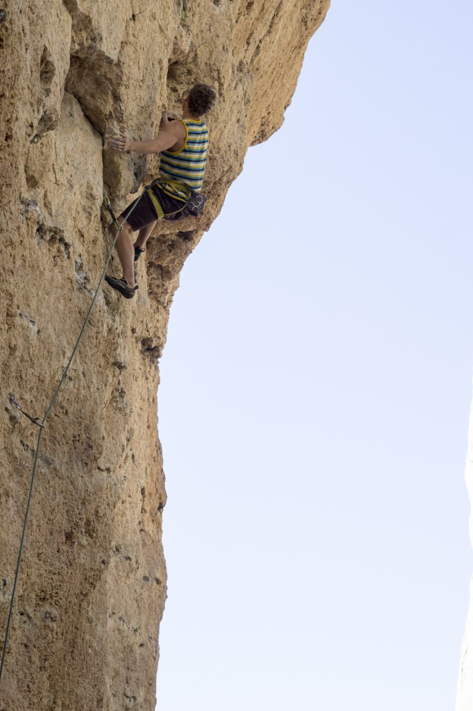 The face on his way up July Jihad (5.12b).