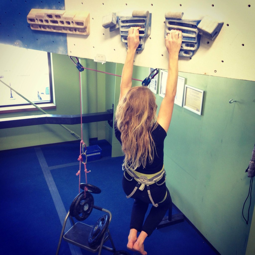 Robyn on the hangboard. The pulley system allows you to hold on to smaller holds by decreasing your body weight. It's also quantifiable so you can track your strength gains.