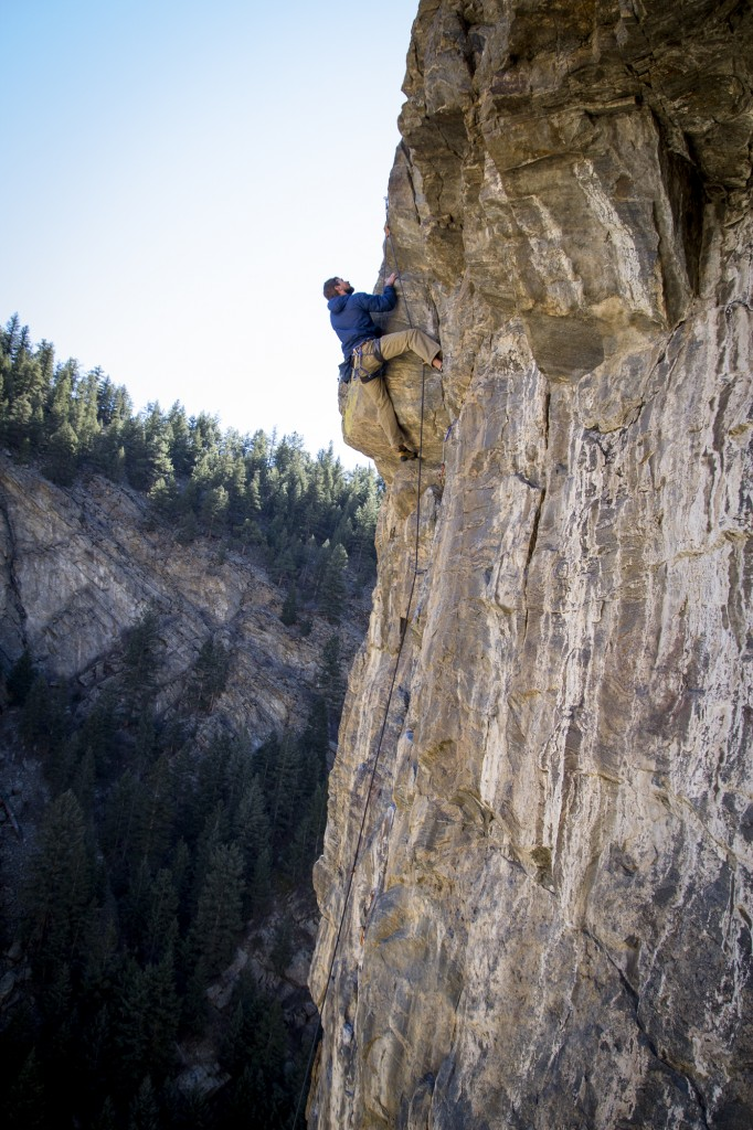 Matt high up on Hours For Dollars (5.10c) at the Capitalist Crag in Clear Creek Canyon.