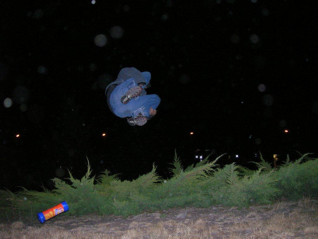 """Marcus engaged in our unofficial Idaho sport of """"bush diving"""". Moscow, Idaho 2004."""