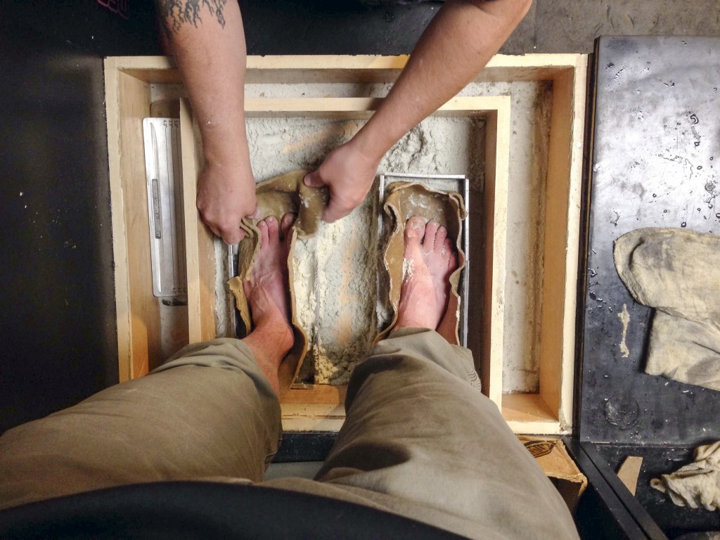 Have a shot, now stick your feet in this wax mould. There is now a plaster replica of my feet living in a storage container between Ketchum and Hailey... Just in case I want some custom footbeds for my ski boots.