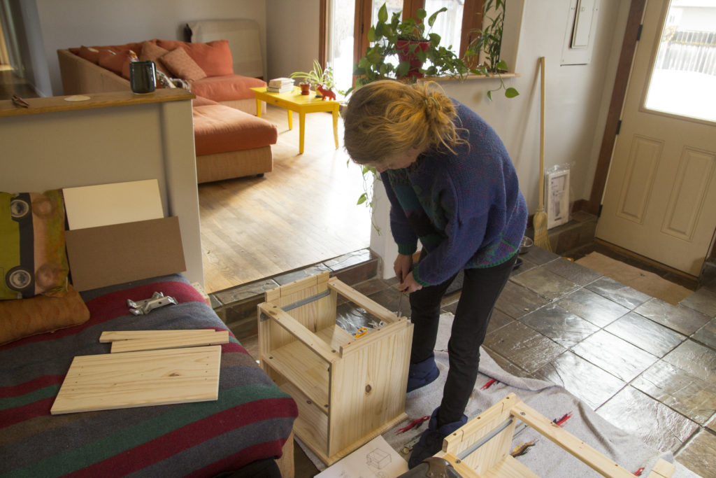 Robyn putting together some nightstands.